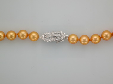 Golden Strand Of Pearls